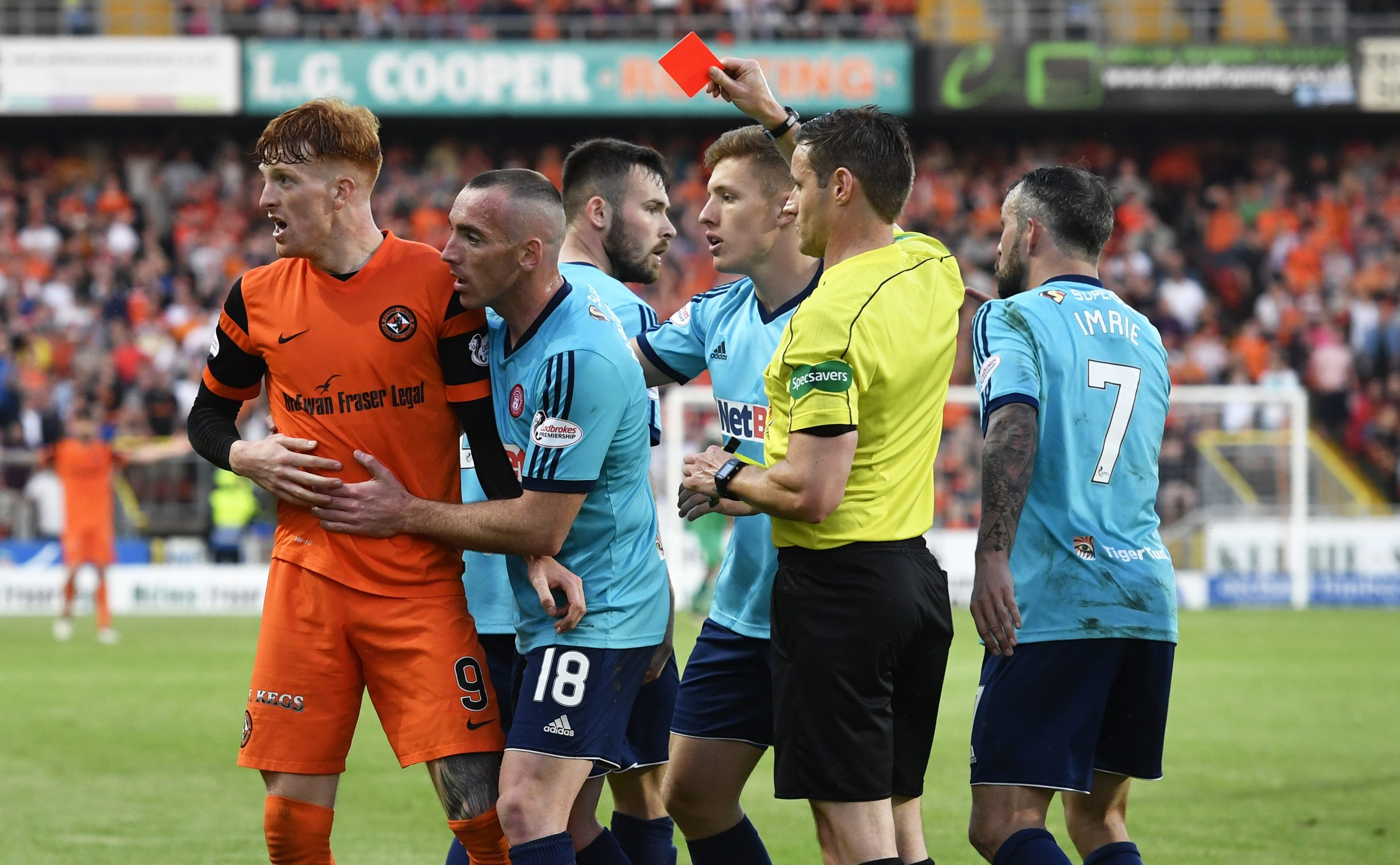 Dundee United's Simon Murray is shown red by Steven McLean