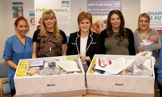 First Minister Nicola Sturgeon gifts first Baby Boxes to expectant parents at the launch of the scheme
