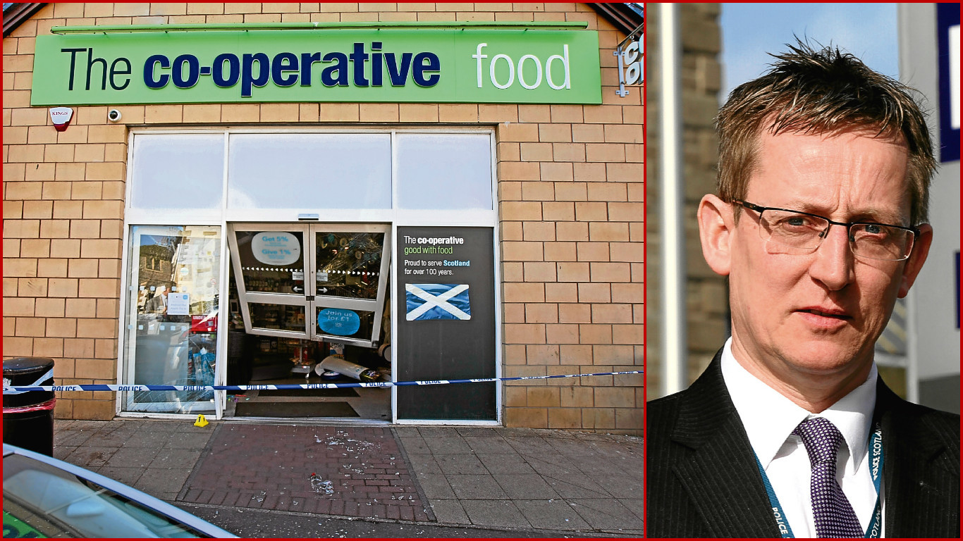 The damaged Co-op shop front and DCI Iain Wales