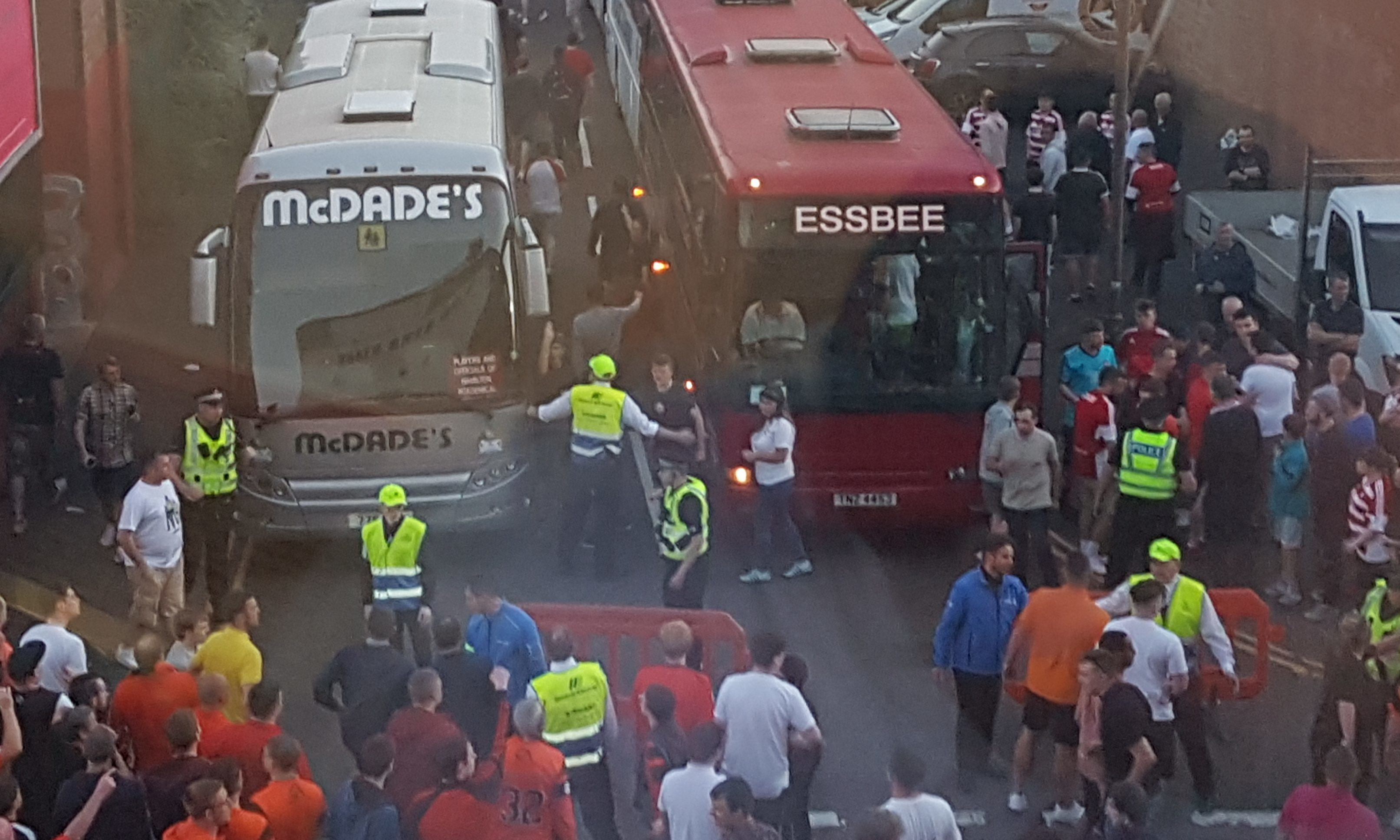 Police and security try to separate Dundee United and Hamilton fans outside Tannadice last Thursday