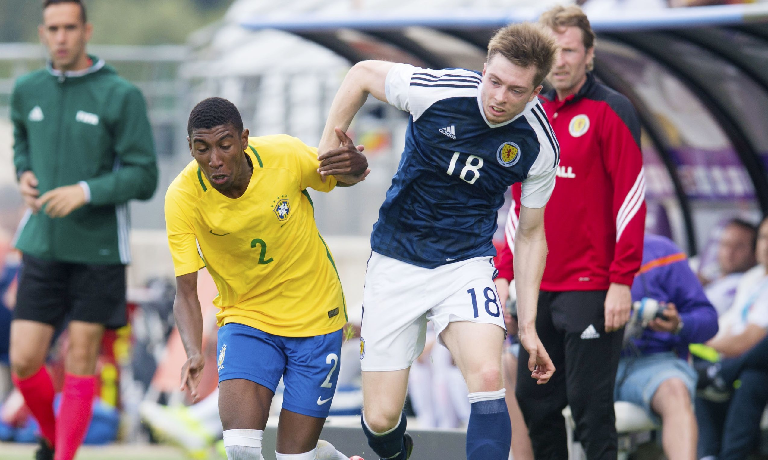 Craig Wighton tussles with Junior Emerson during Scotland's 1-0 win over Brazil in the Toulon Tournament.