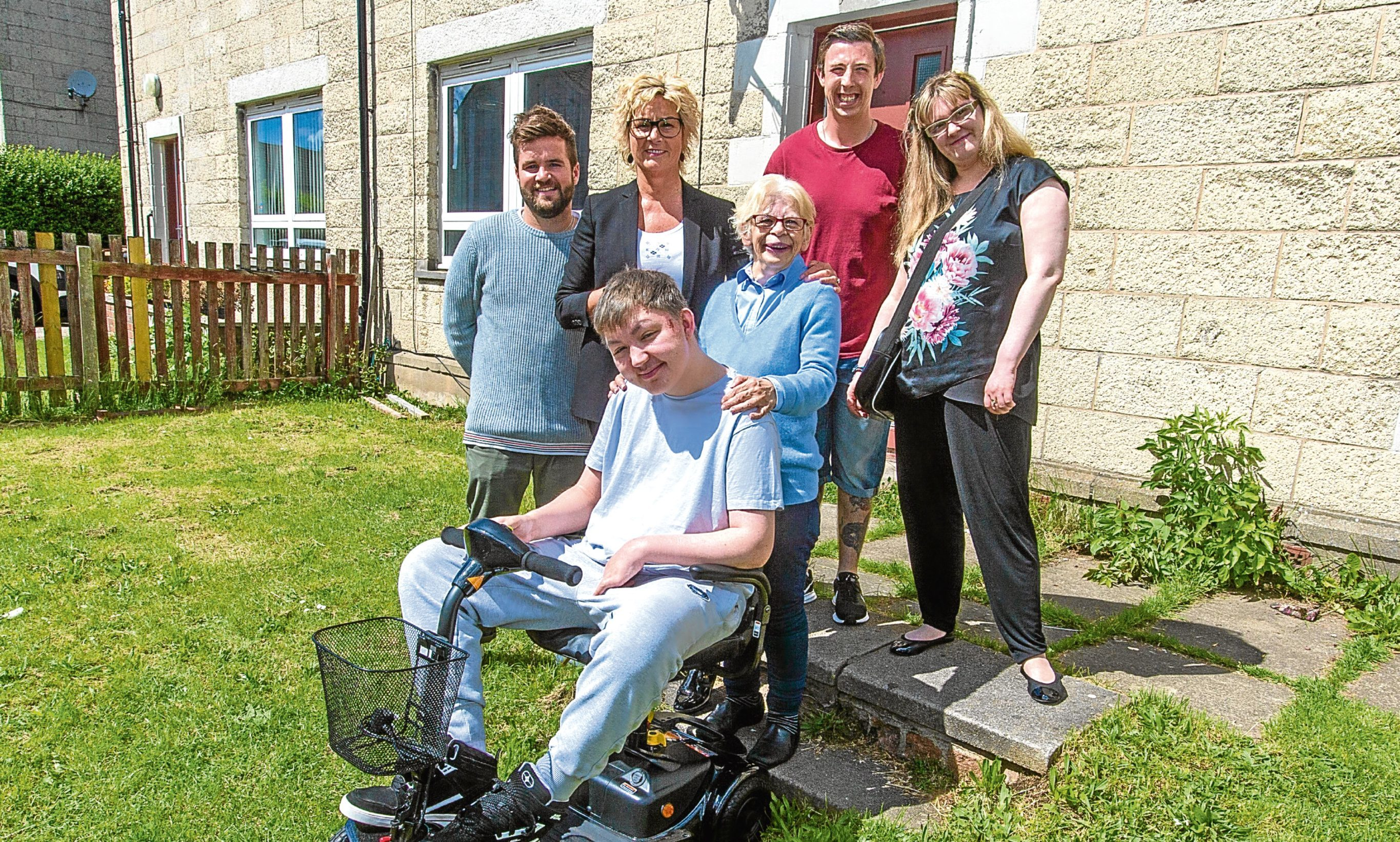 Avril Kerr (centre), along with members of Westlands Supported Accommodation (from left) Rhys Kerr, Helena Sutherland, David Burnett and Shannon Fairweather, presents the scooter to Gary Deasley.