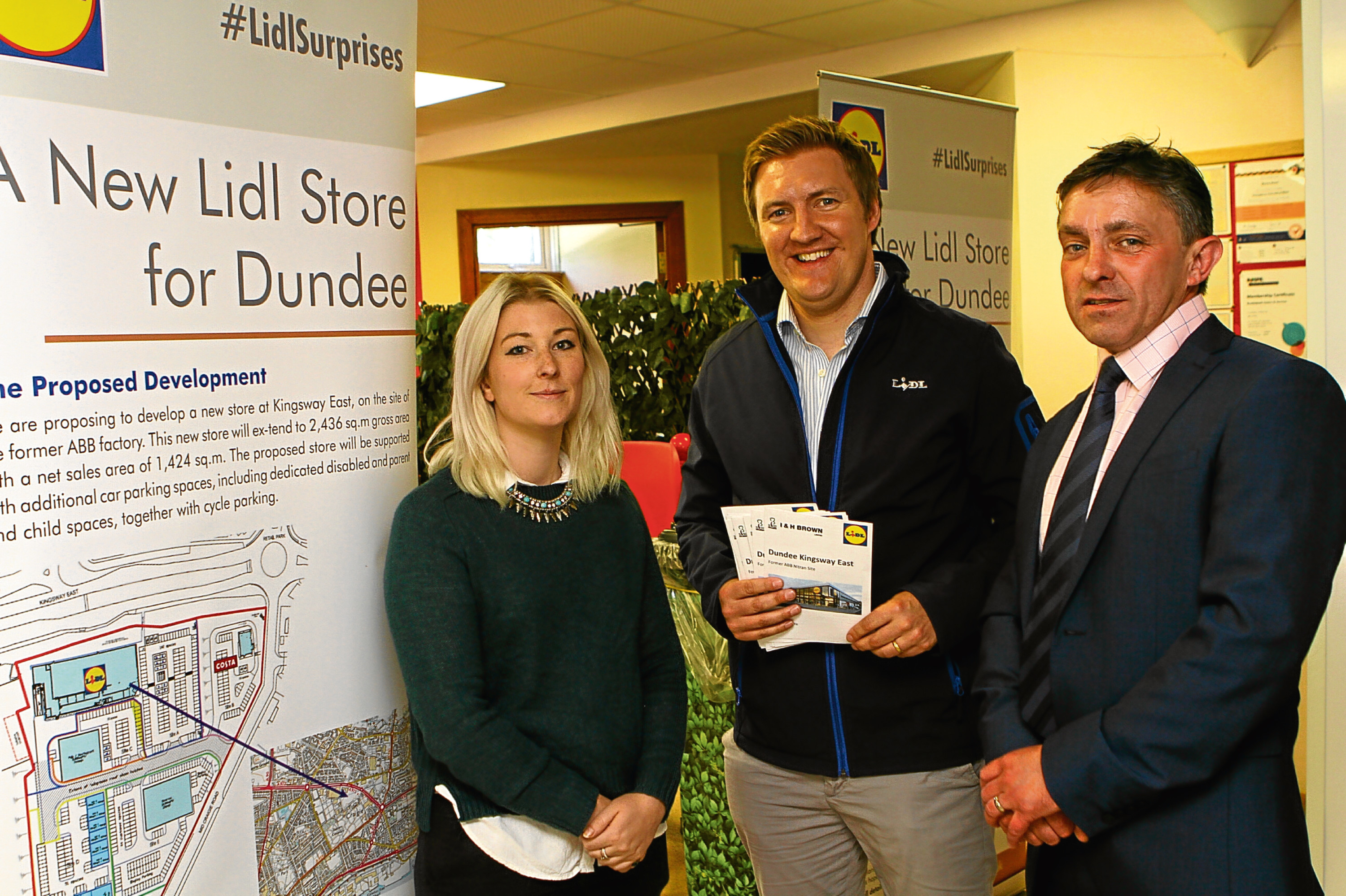 Picture shows Kim Steele and David Durie, both of Lidl, with Tommy Devlin (right), development manager at I&H Brown Developments.