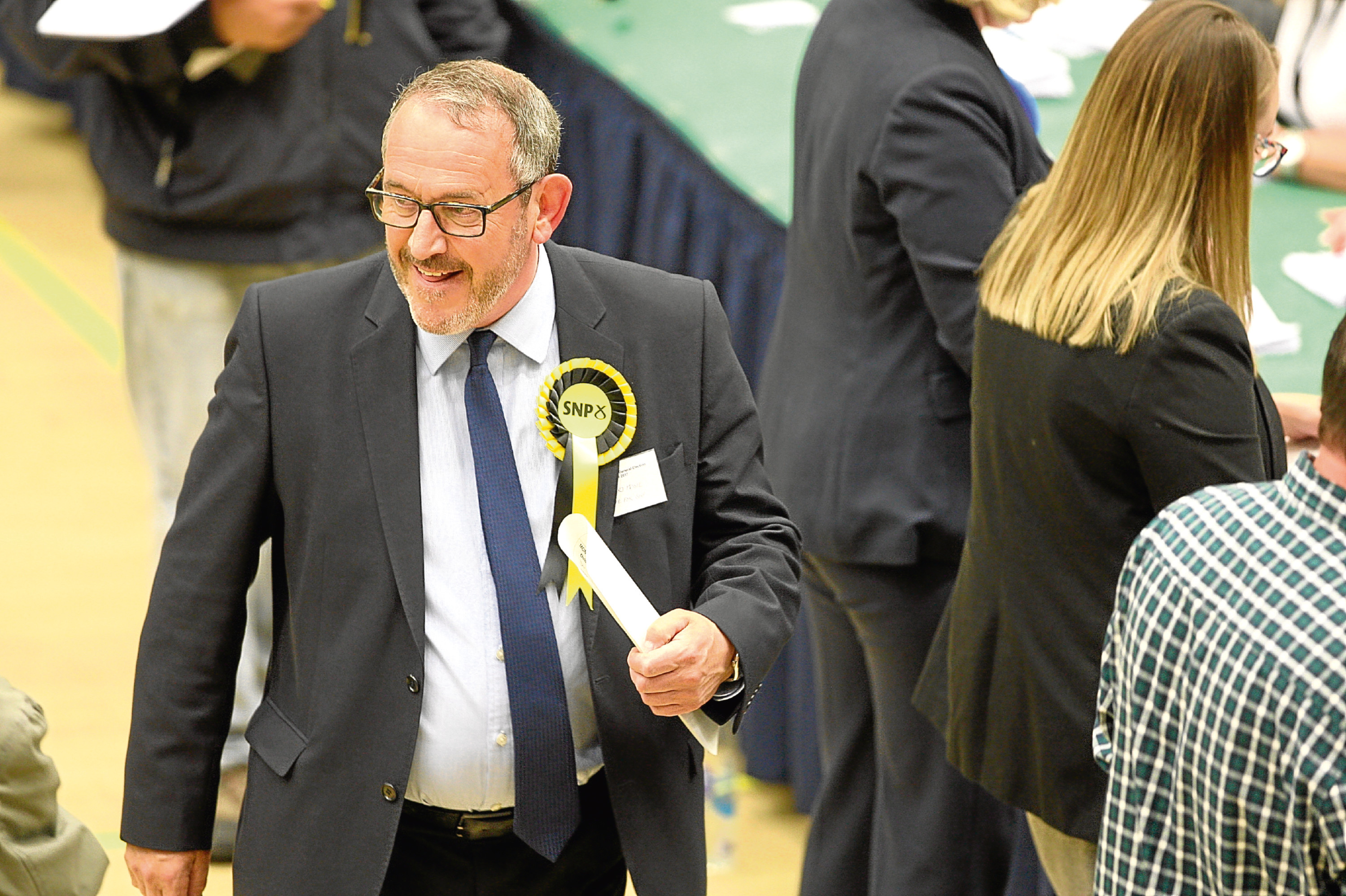 Smiles all round: The SNP's Stewart Hosie was elected as MP for Dundee East for a fourth term.