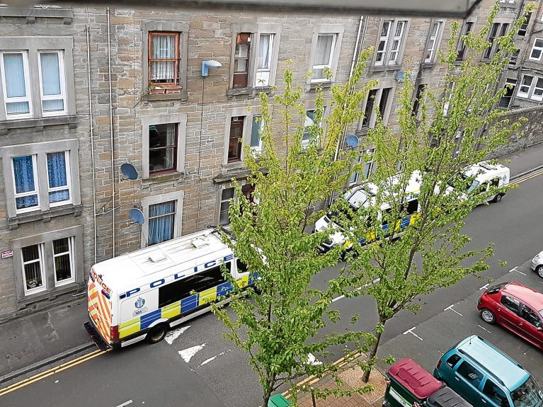 Police in Baldovan Terrace while they carried out a drugs bust at a flat in the street.