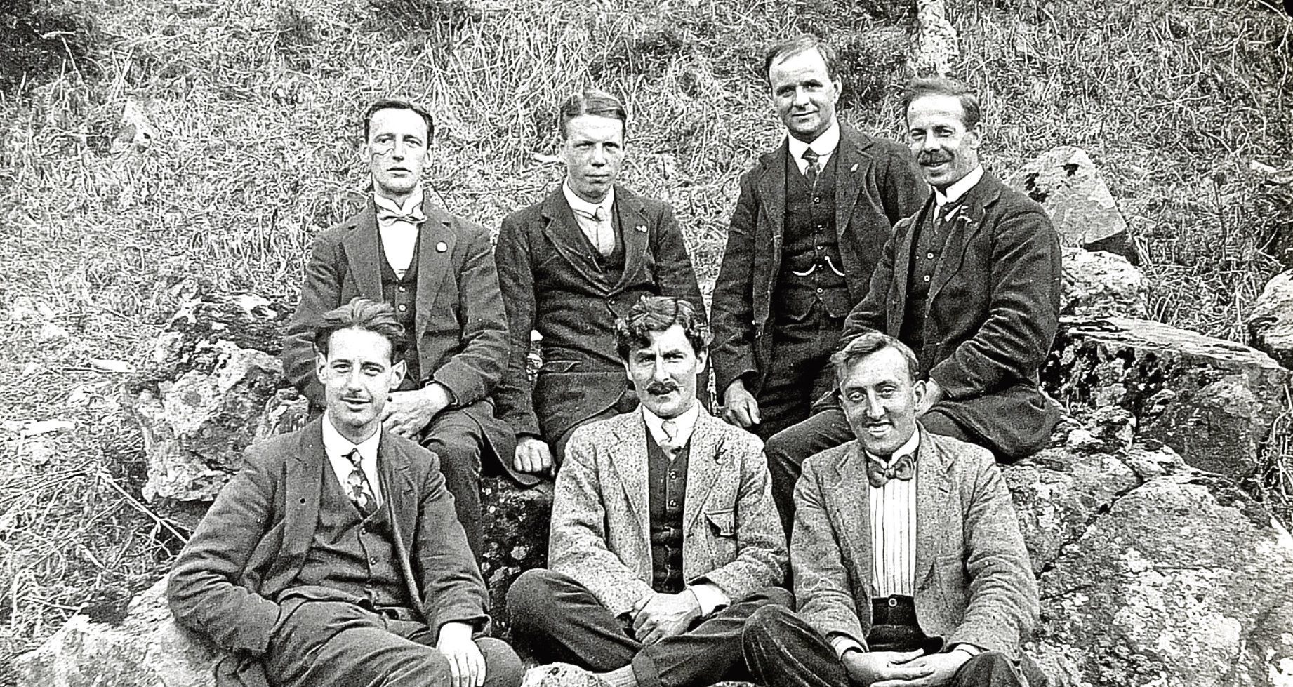 """Standing in the back row are Alexander """"Sandy"""" Ross, back row second right, and Ewan Geddes Carr, far right. The identities of the other men are unknown"""