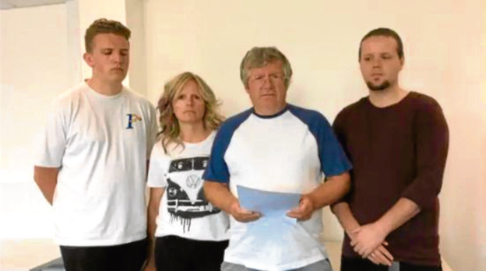 A still from the video in which Gordon, centre, made an appeal about wife Patricia surrounded by family.