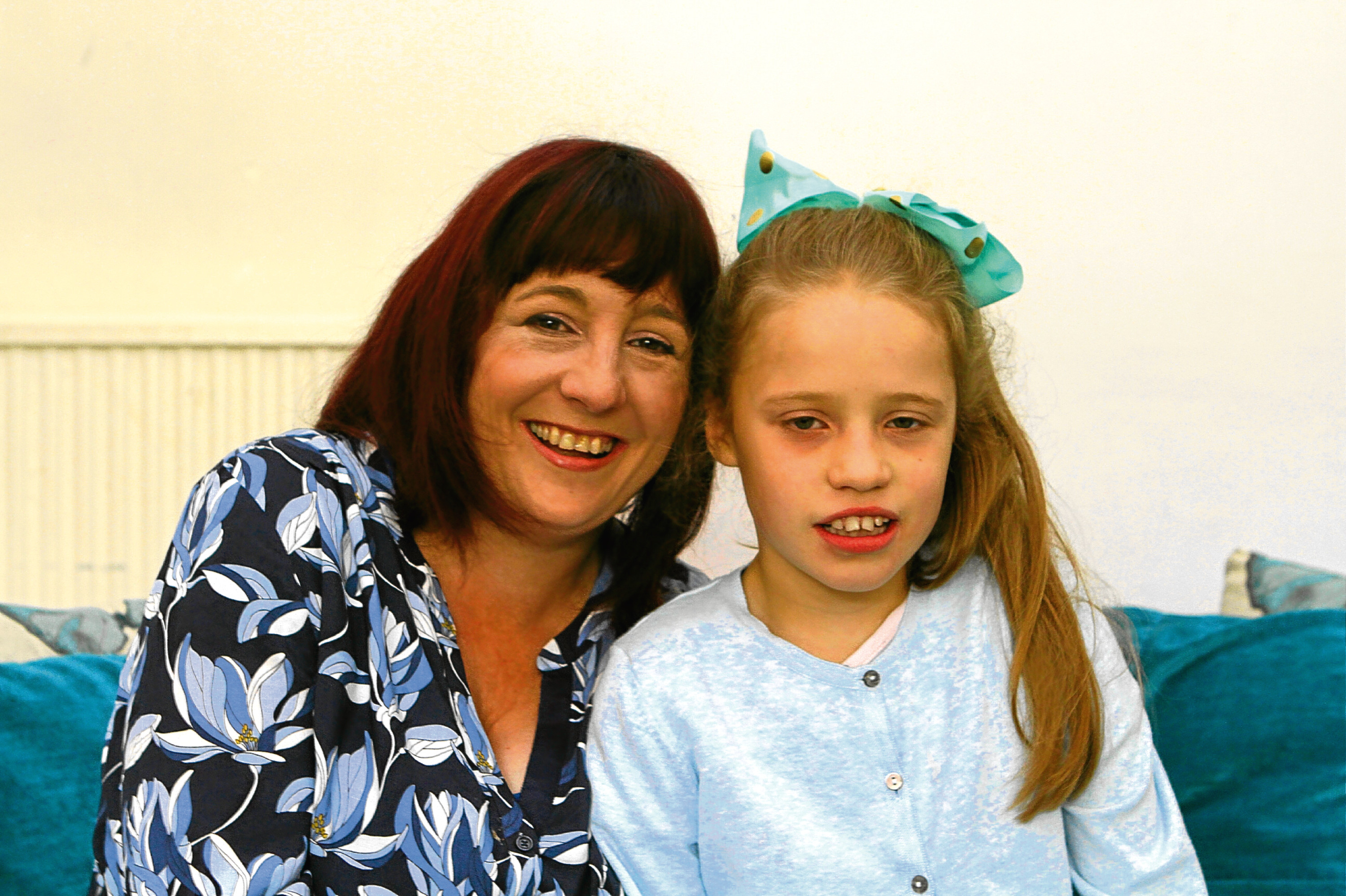 Mum Shona Thomson at home in Broughty Ferry with daughter Emily Gray
