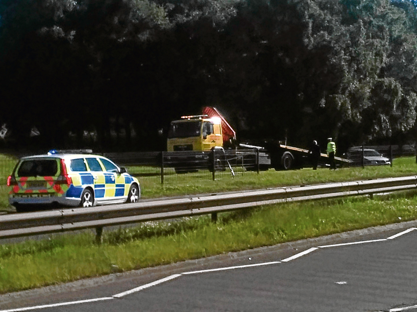 Police and a recovery vehicle at the side of the A92 in Dundee following the alleged chase.