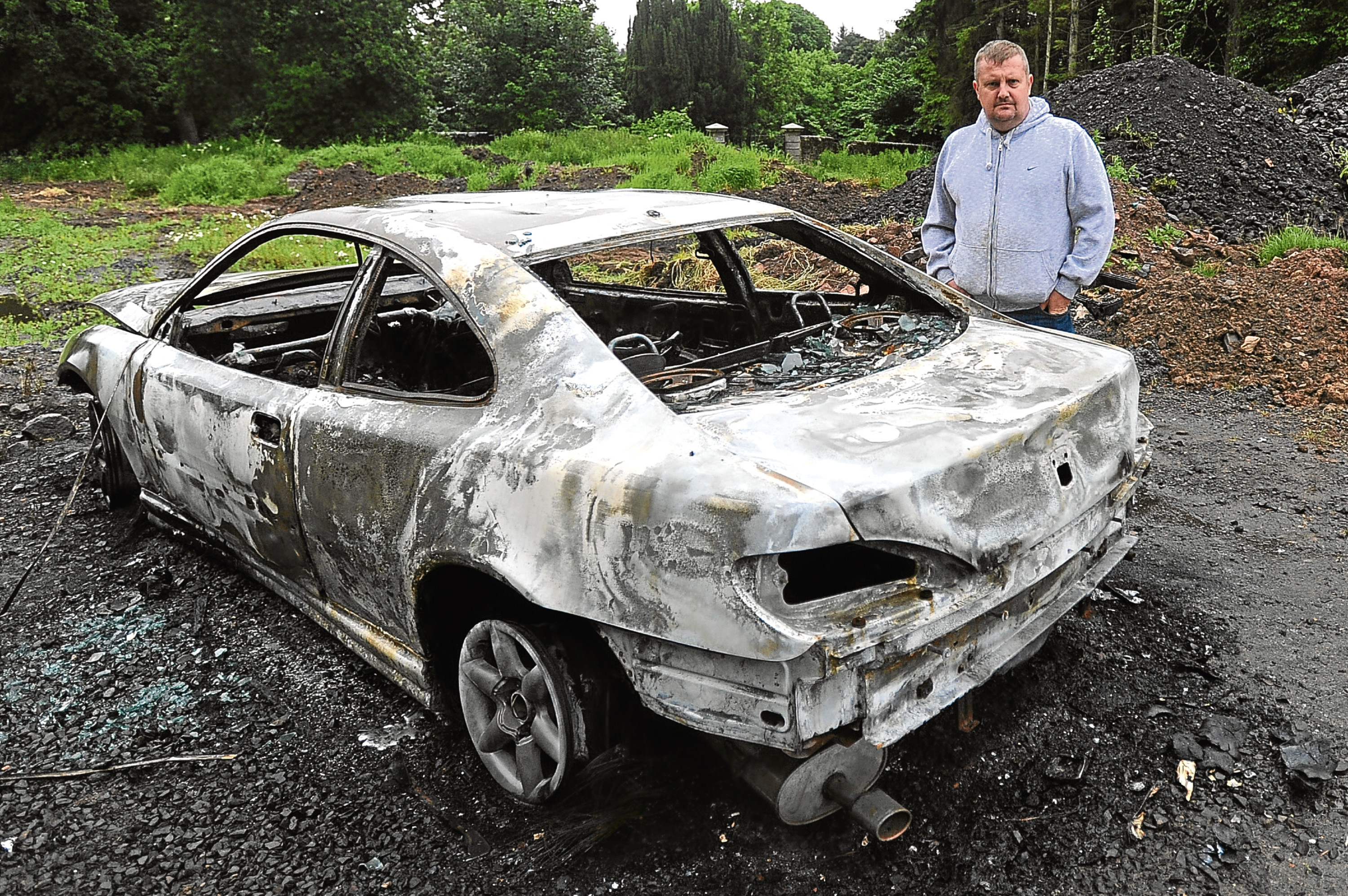 Dean Duncan has hit out at vandals after a burnt-out car was left in the grounds of Mains Castle — prompting fears his business could be affected.