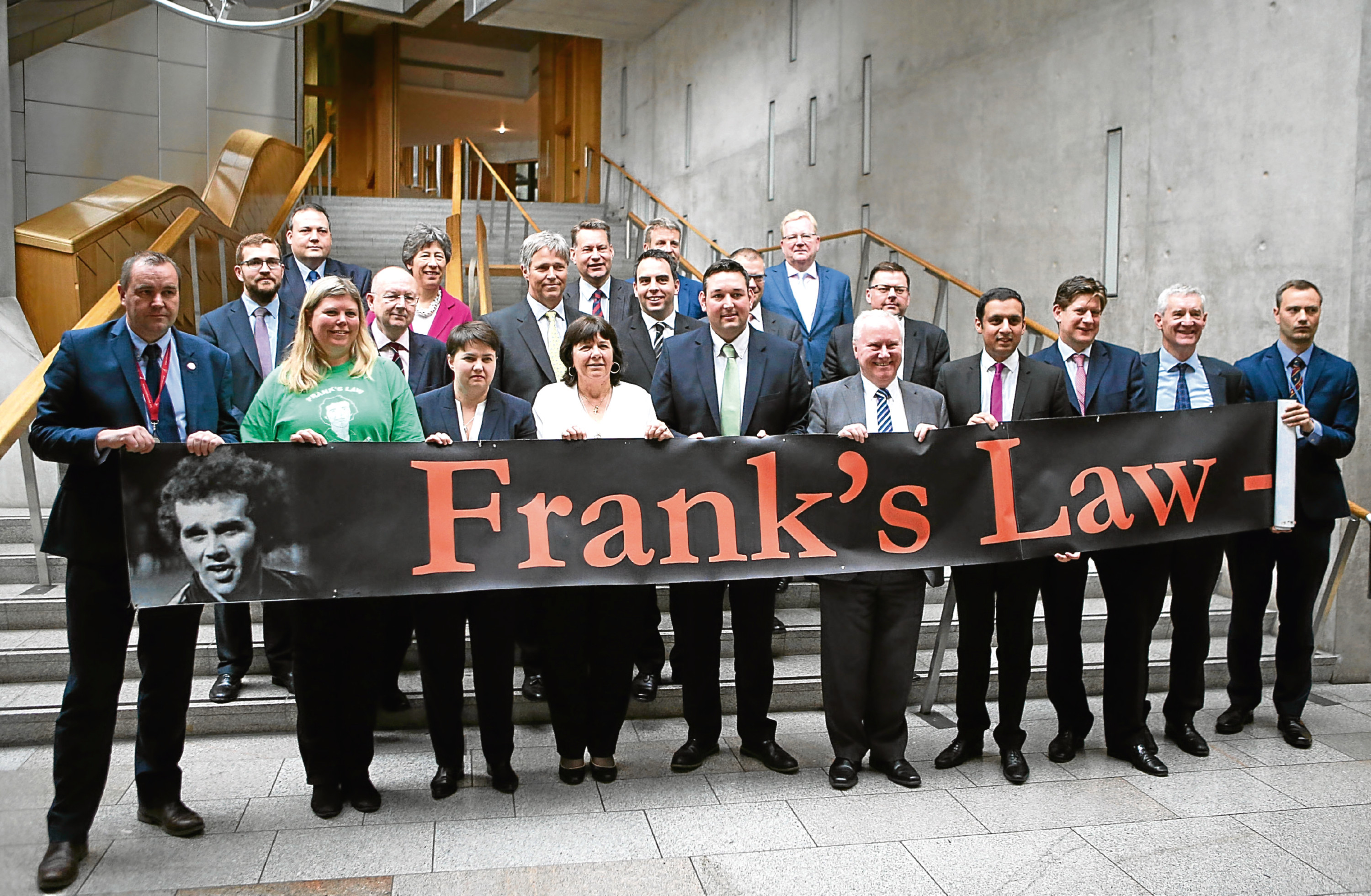 MSPs joined Amanda Kopel (front, fourth left) and campaigners at the Scottish Parliament.