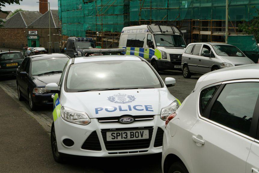 Police vehicles on Fairbairn Street