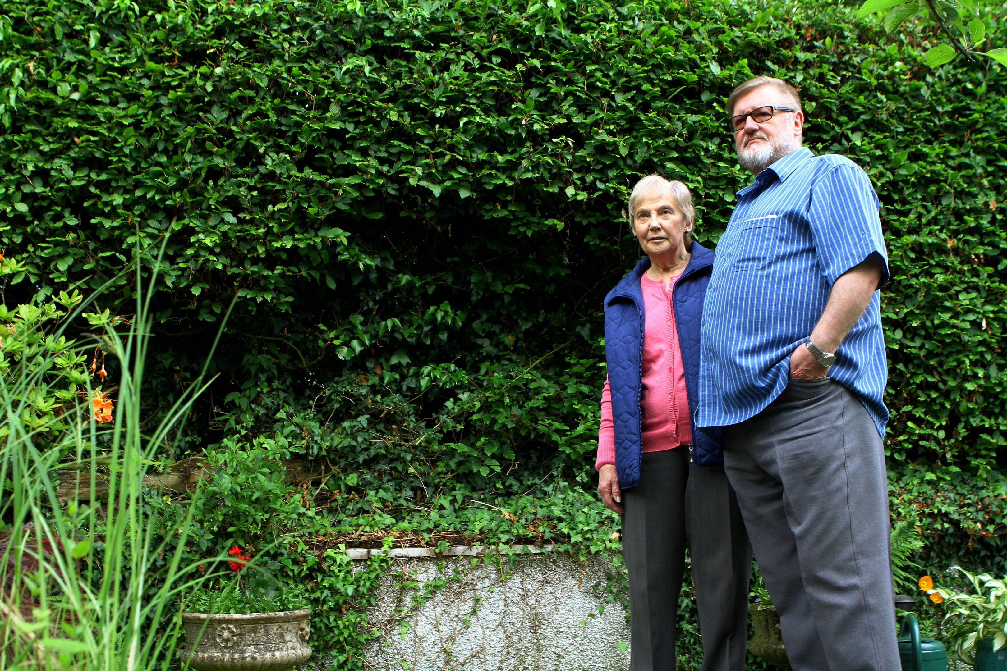 Barbara and John Dow beside the spot where the chair was stolen.