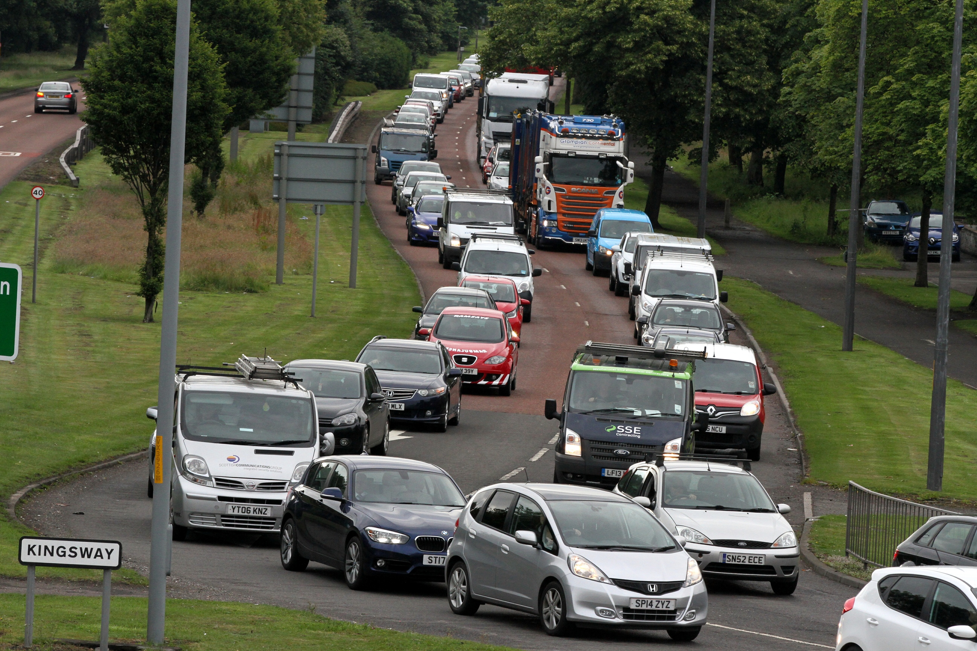 Traffic queuing towards the Old Glamis Road roundabout during rush hour, close to where the crossings are planned.