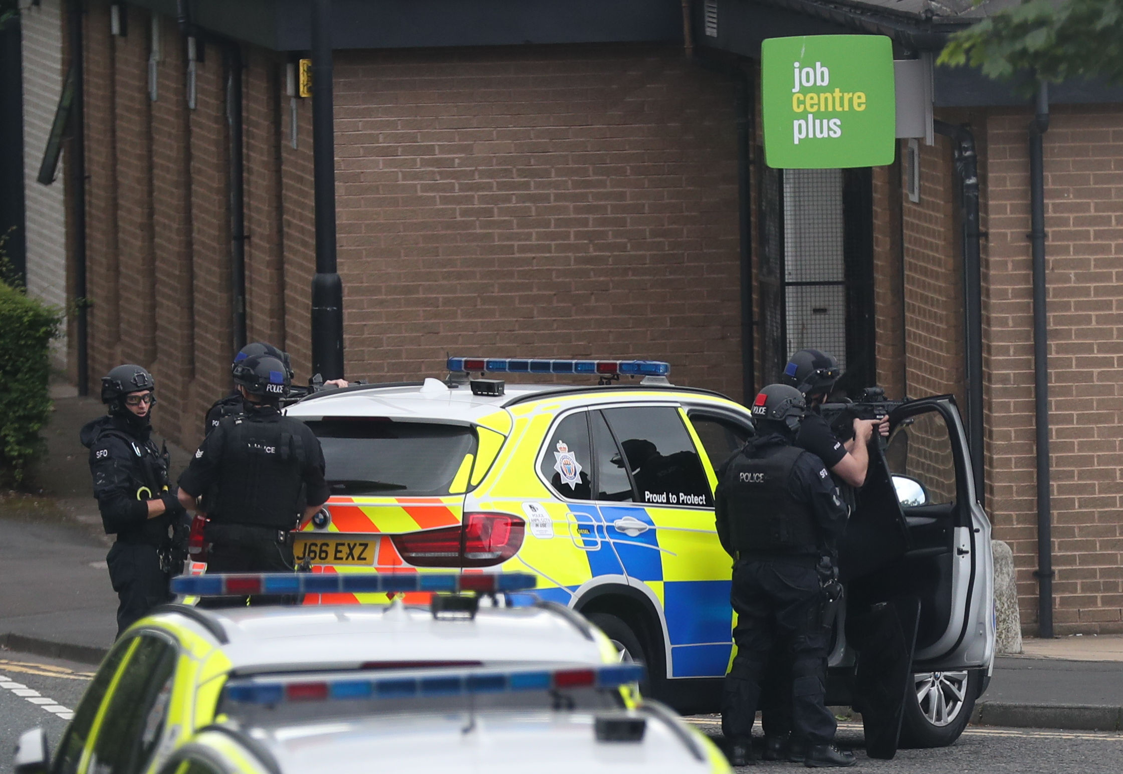 Armed police outside a Jobcentre where a man armed with a knife took people hostage