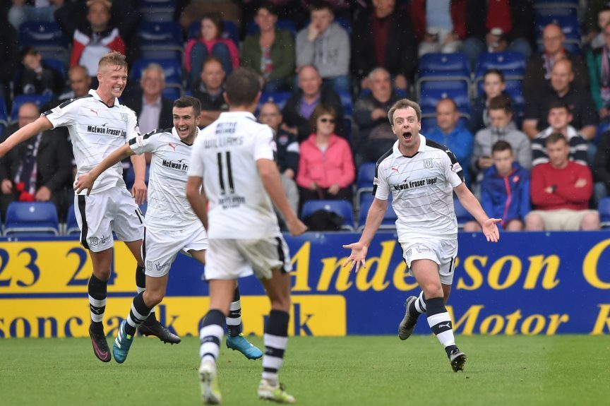 Paul McGowan (right) celebrates putting Dundee 3-0 up in Dingwall on the first day of last season.
