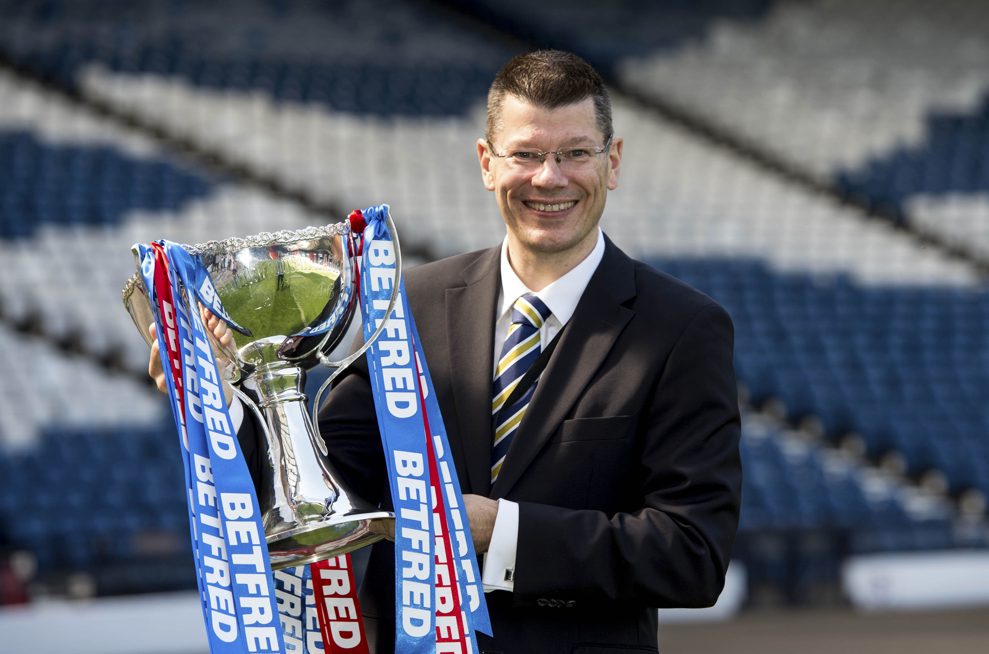 SPFL chief executive Neil Doncaster with the Betfred Cup.