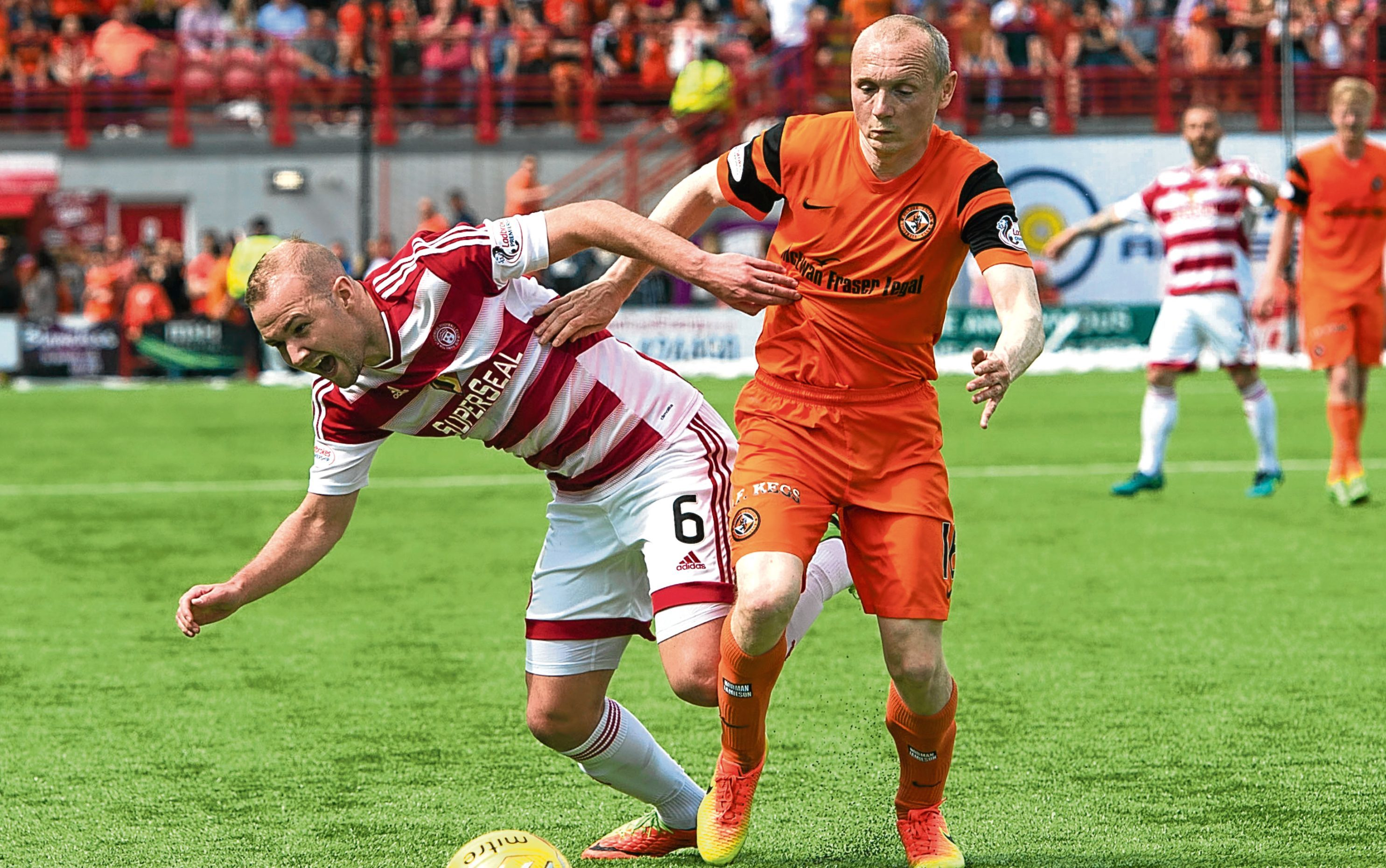 Dundee United midfielder Willo Flood tussles for the ball with Hamilton's Grant Gillespie in the Premiership play-off final second leg at the Superseal Stadium in May.