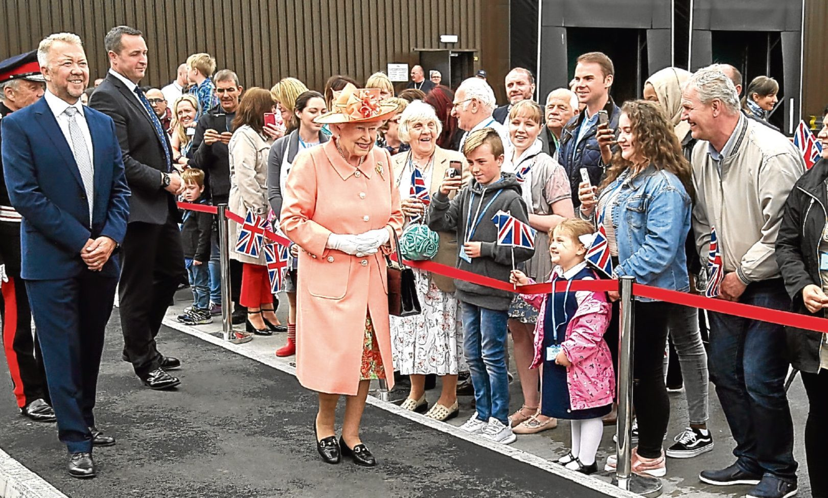 The Queen greets the crowds  on her arrival