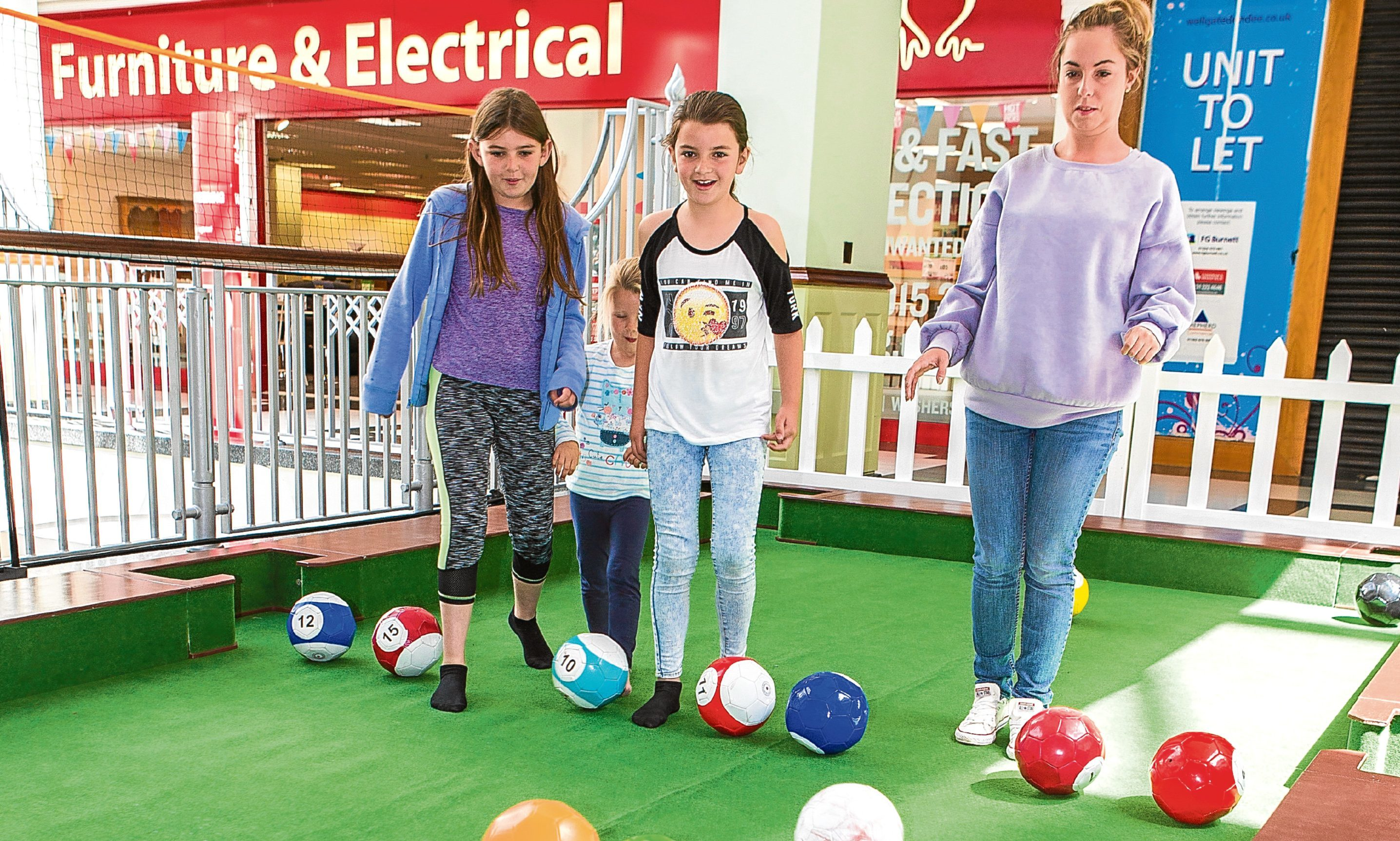 n Pictured are Abbi Williams, 10, Morven Couper, 4, and Erin Williams, 8, from Forfar, playing snookball under the watchful eye of Stephanie Robertson, 22, from Carnoustie.