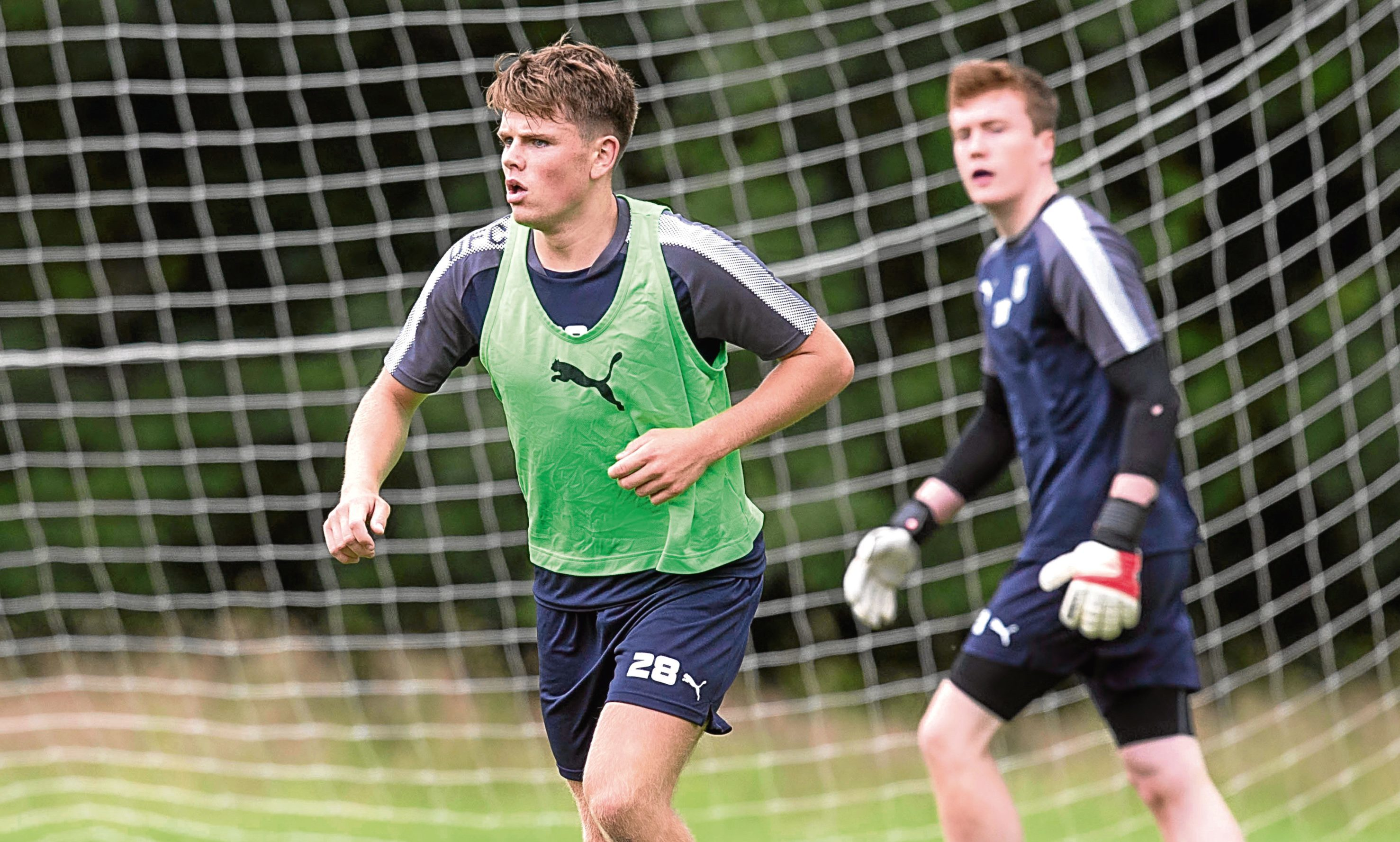 Dundee's Lewis Spence in training