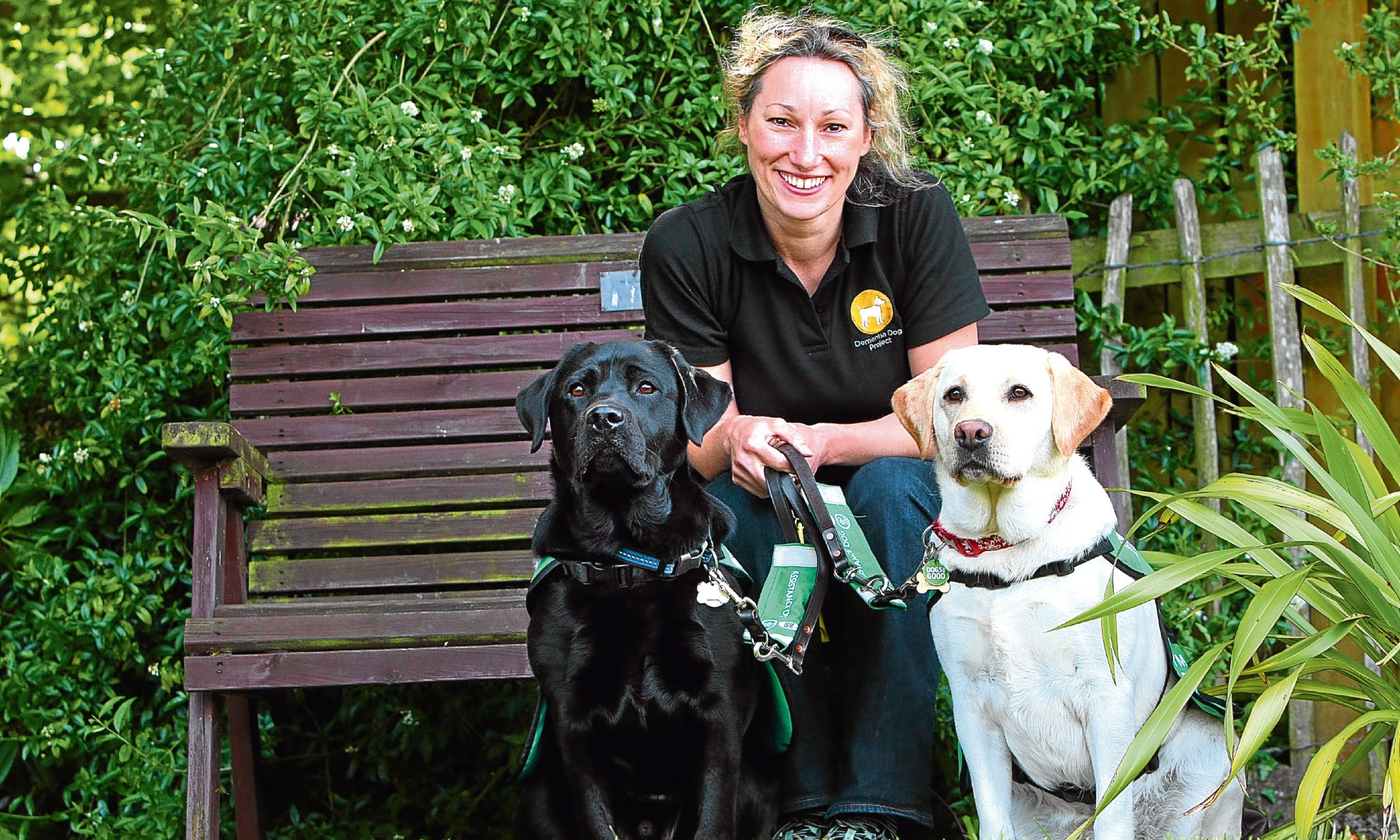 Fiona Corner, project manager, with Webb and Willow the dementia dogs