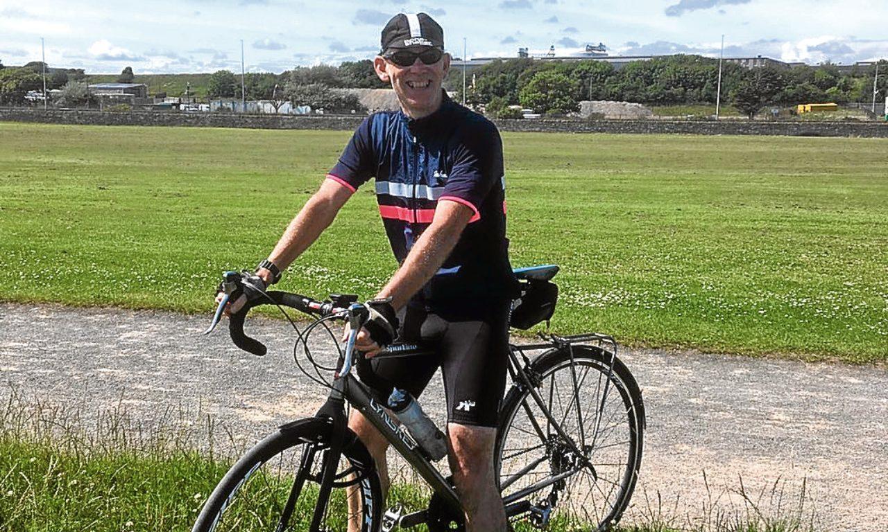 Donald Baddon on his bike.