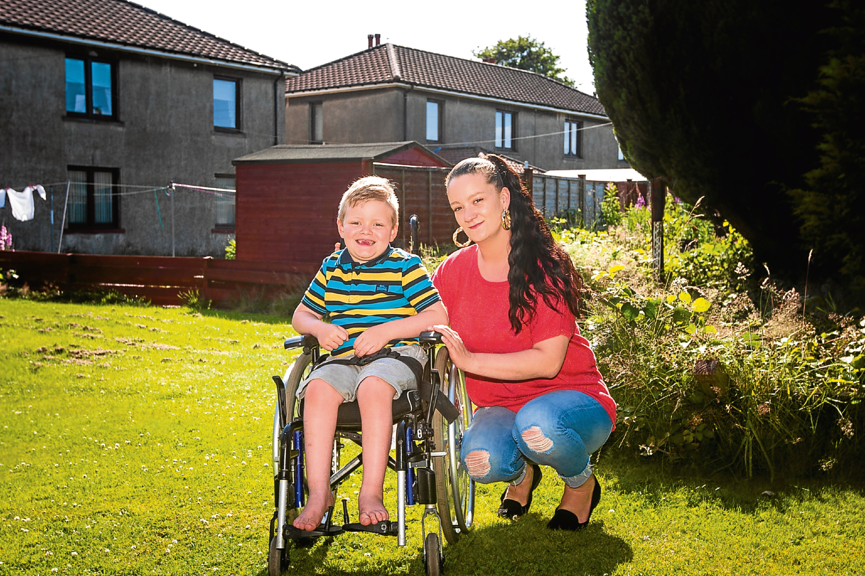 Six-year-old Kayden Maynard-Scott pictured with his mother Jacqueline Tollady, who has launched a fundraising bid to cover his annual physio bill.
