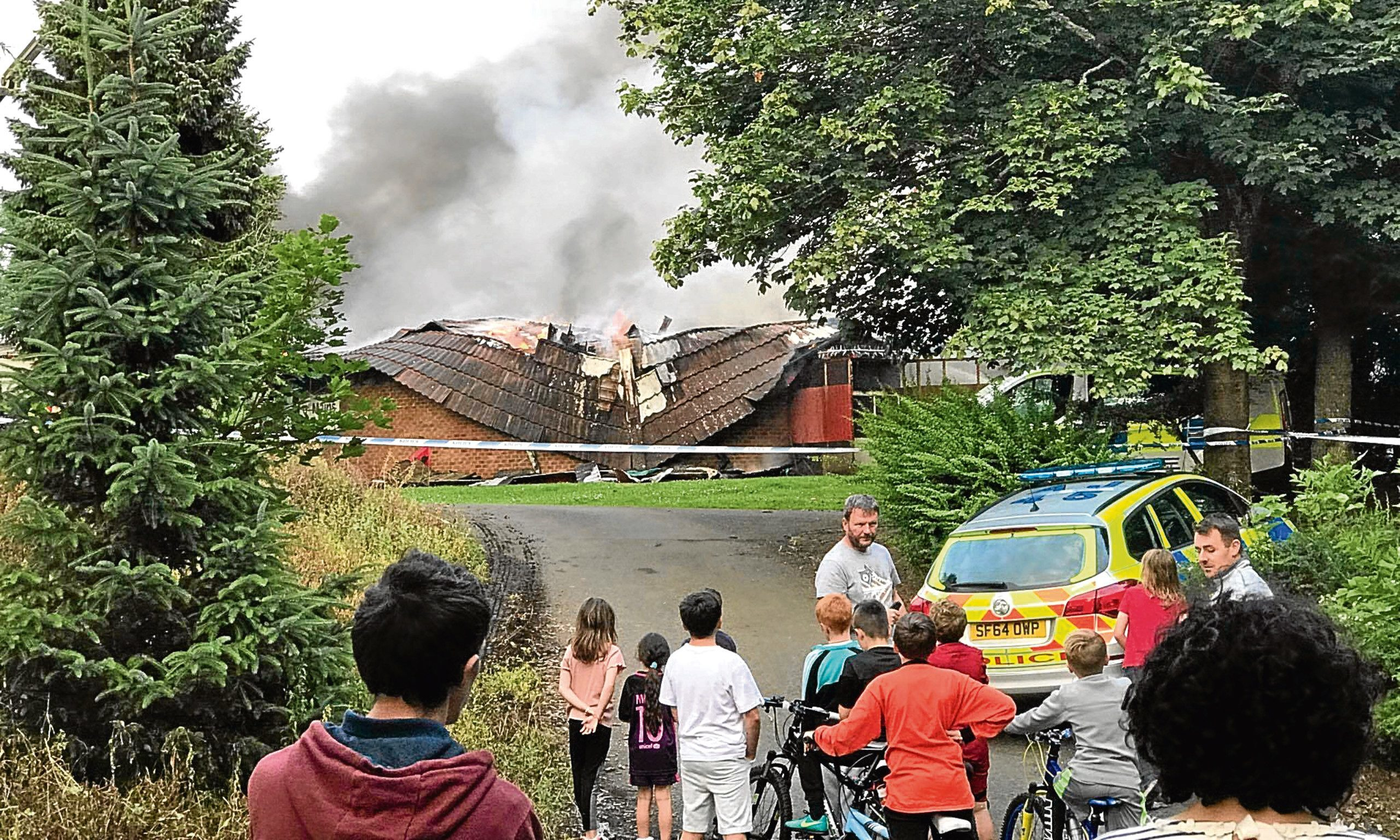 Shocked onlookers when the community pavilion went on fire in 2013.