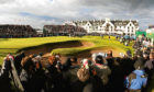 Crowds watch and photographers cover the presentation after the completion of the 136th Open Championship at Carnoustie on July 22 2007
