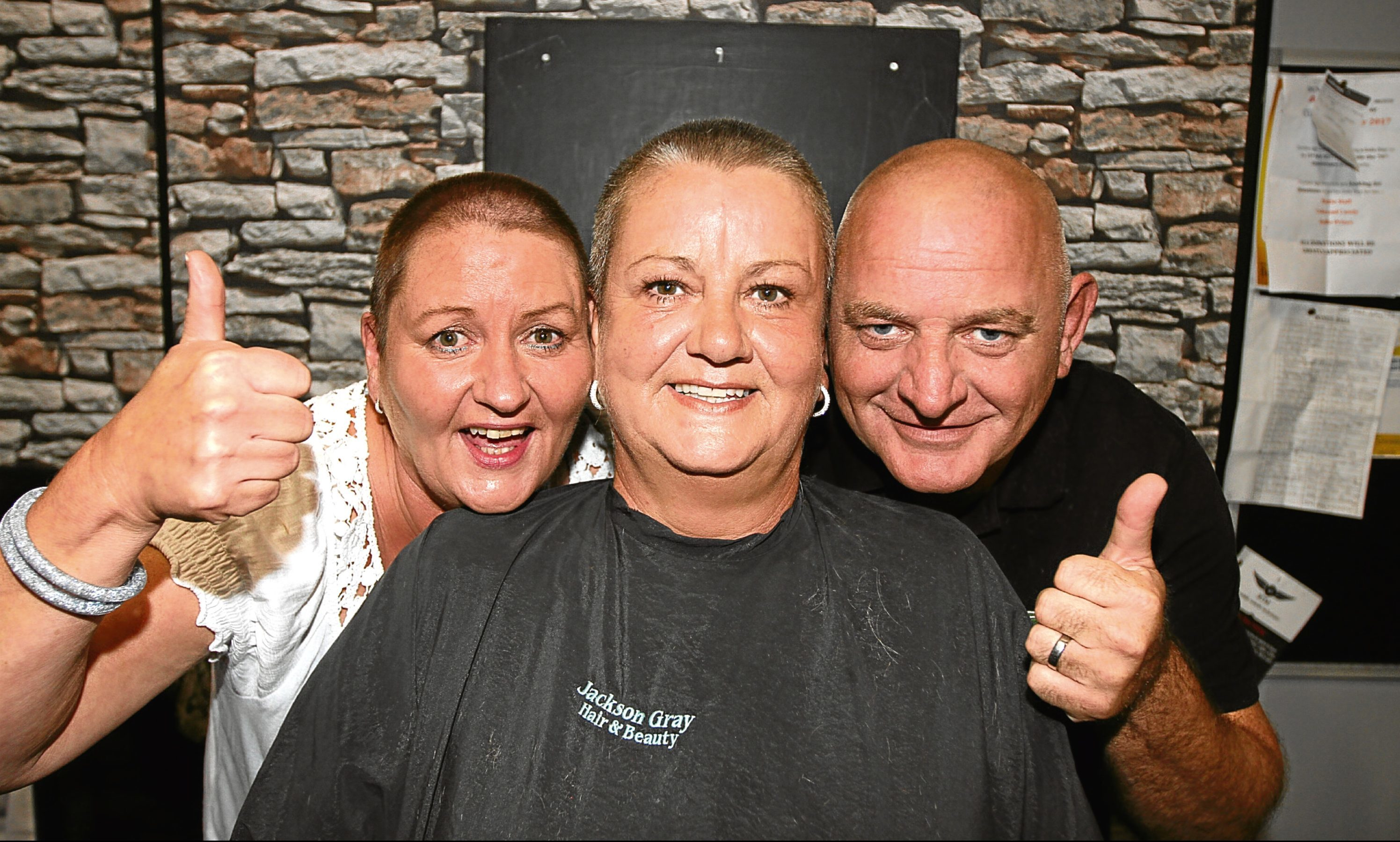 Joan Storrie (57)  Ann Skene (57)  and Bobby Skene (52) after getting their heads shaved