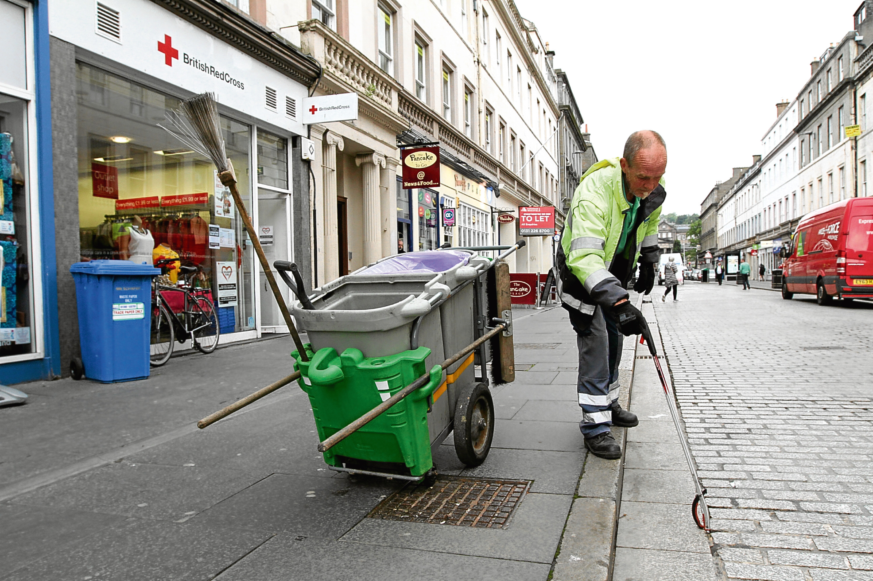 A council street cleaner in the city.