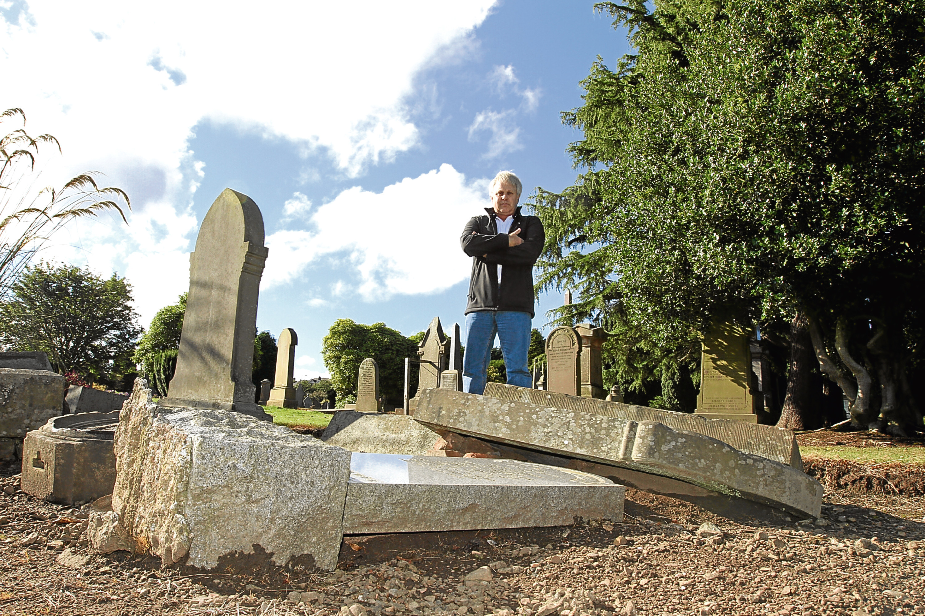 Paddy McArtney, from Maryfield, pictured in Eastern Cemetery which he has described as looking like a bomb site.