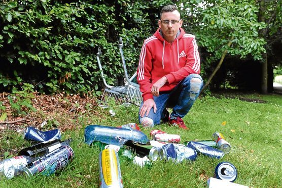 Matthew Sansbury has raised concerns about the rubbish on a pathway leading up to the Carseview Centre in Menzieshill.