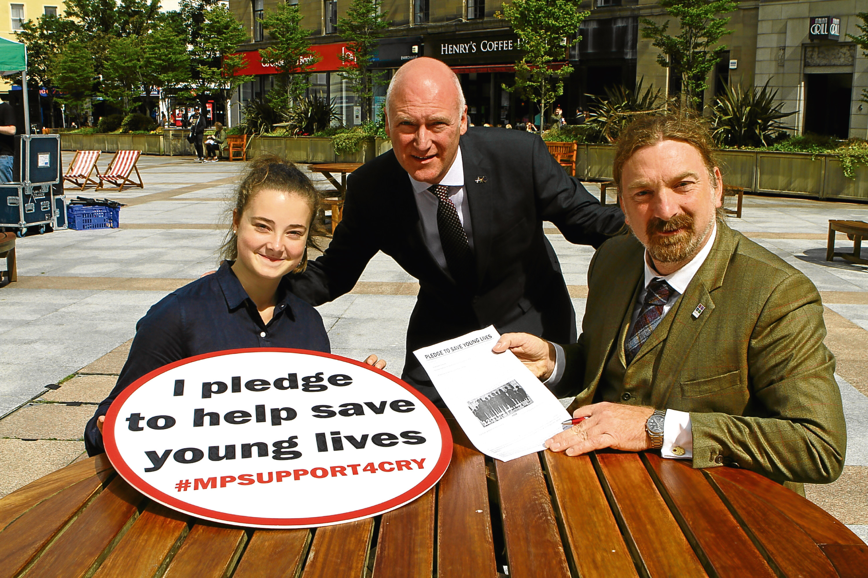 Abby Lang with Joe FitzPatrick MSP, centre, and Chris Law MP in the City Square.