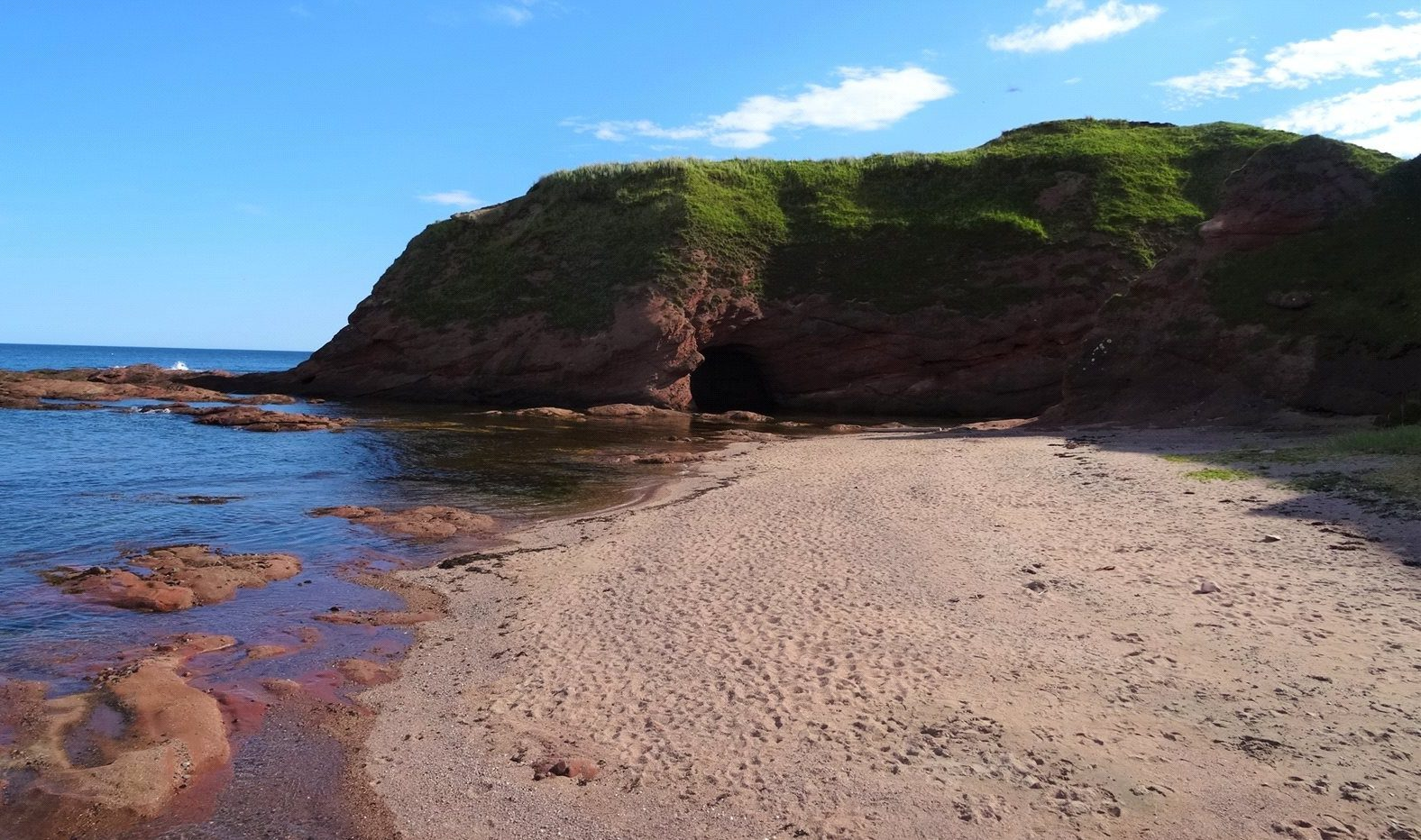The beach comes with caves, wildlife and a farmhouse, which needs an upgrade. Image courtesy of Galbraith
