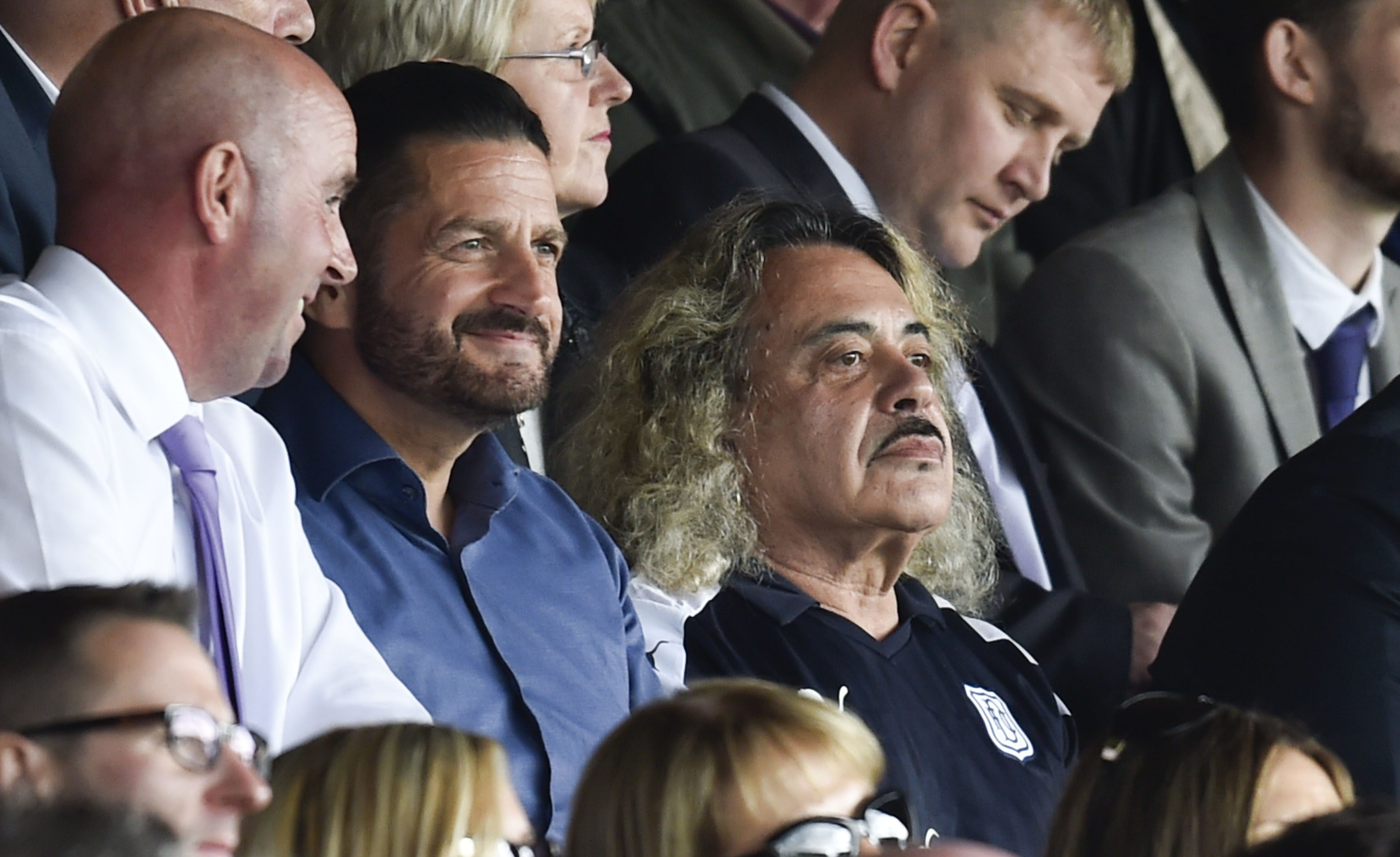 Paul Anderson (blue shirt) sits next to Wagner in the Main Stand.