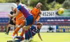 Paul McMullan is brought down in the box. Inverness gaffer John Robertson felt the United man went down too early.