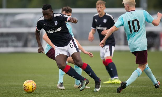 Dundee trialist Khalid Aucho in action yesterday