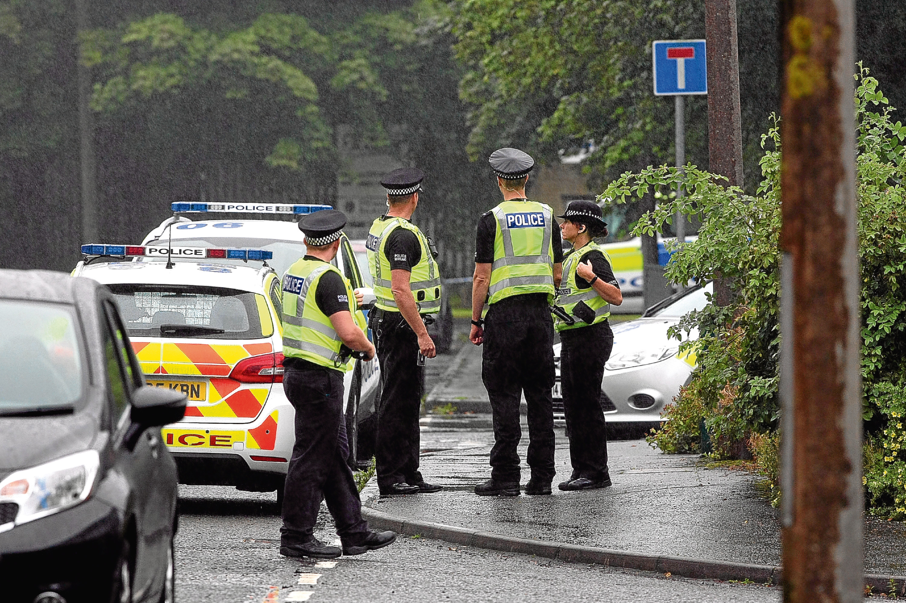 Police at the scene of the West Pitkerro Industrial Estate incident