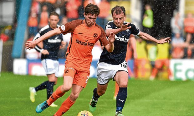 Sam Stanton — seen here tussling for the ball with Dundee's Paul McGowan — enjoyed his first city derby when the Tangerines earned the penalty shootout extra point at Dens last Sunday.