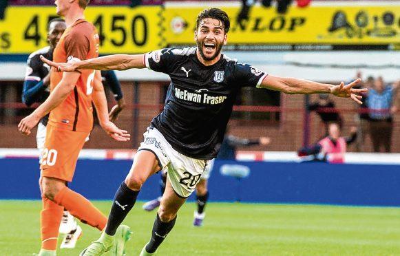 Goalscorer Faissal El Bakhtaoui celebrates after scoring.