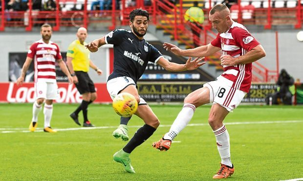 Faissal El Bakhtaoui and Darian MacKinnon battle for the ball during Dundee's 3-0 Premiership defeat against Hamilton in Saturday's game at the SuperSeal Stadium.