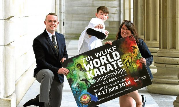 Roy O'Kane with Young Sports Person of the Year Oliver Bruce, 13, and Councillor Lynne Short