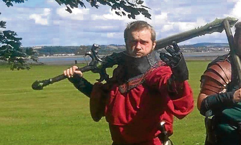 Samuel Greaves holding the 'sword'.