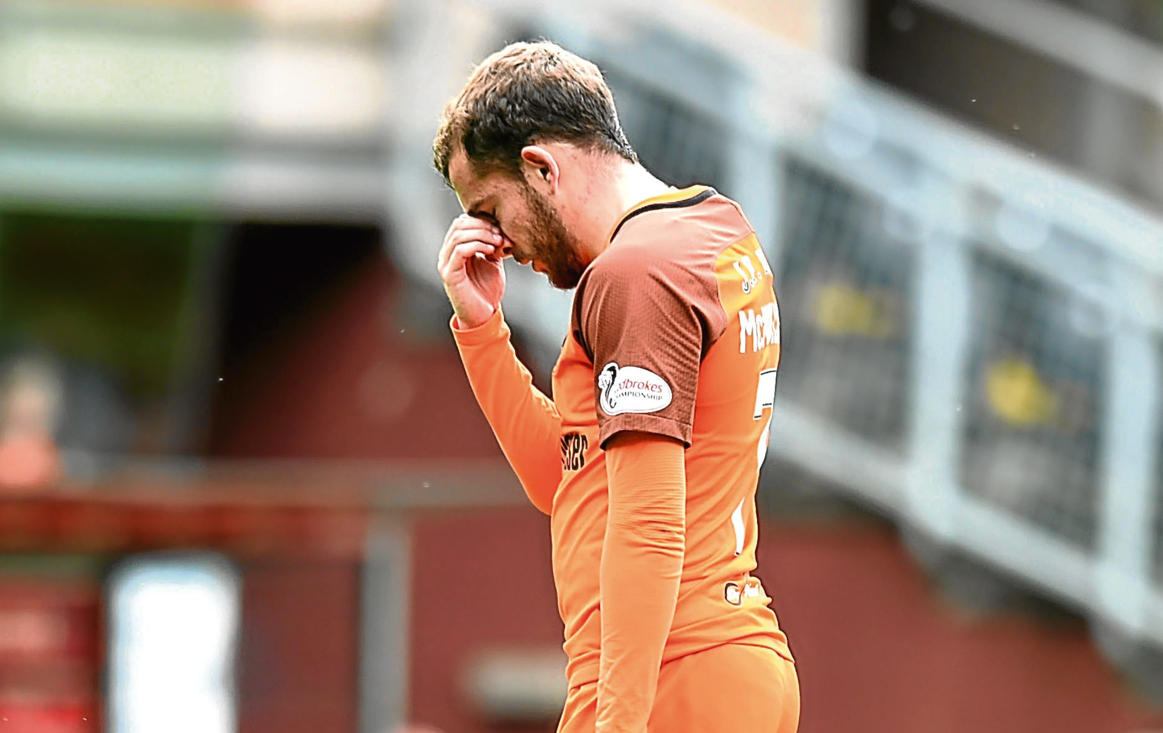 Dundee United's Paul McMullan cuts a dejected figure as he is sent off for an early bath after his sending-off offence.