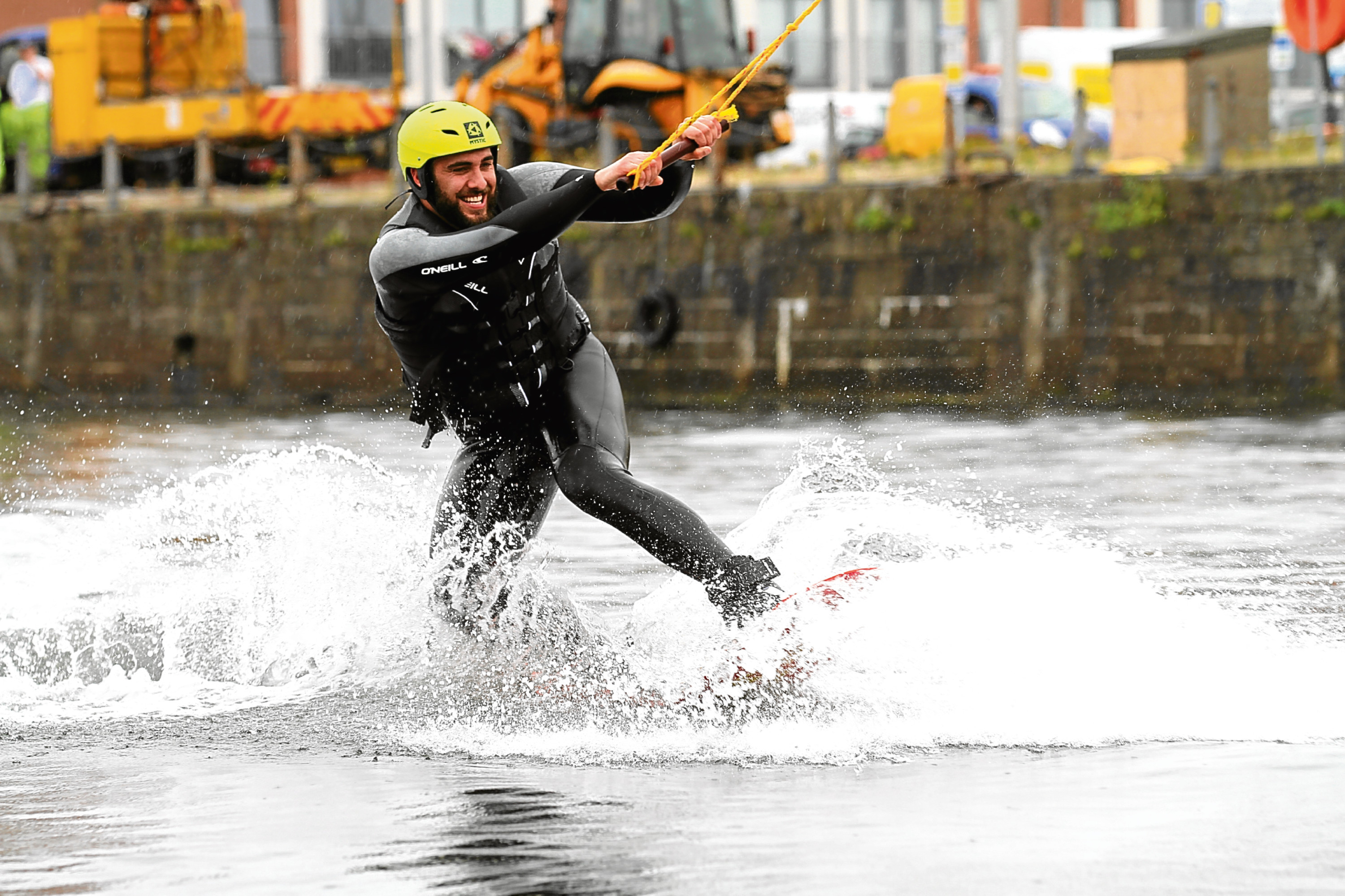 Tele reporter Adam Hill cuts a few moves on the wakeboard during the opening of the facility.