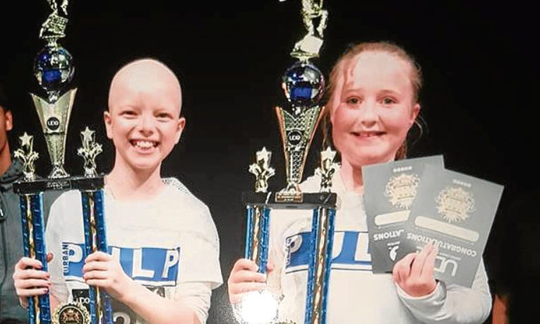 Lily (left) and Holly with their trophies