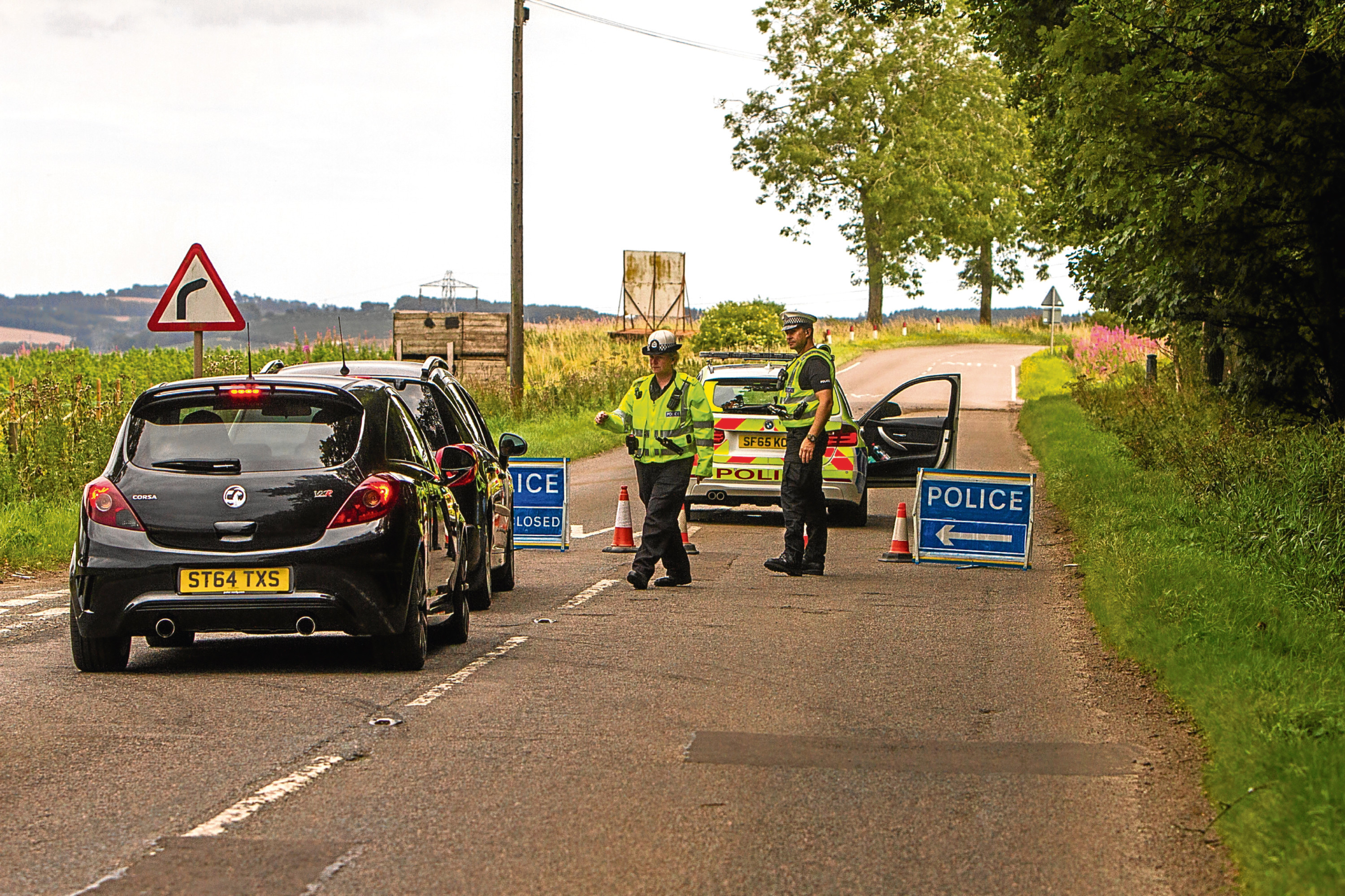 Police divert traffic after a fatal accident on the A923 near Piperdam