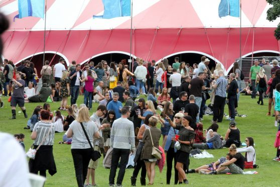 Revellers head for the Rhumba tent at Carnival Fifty Six